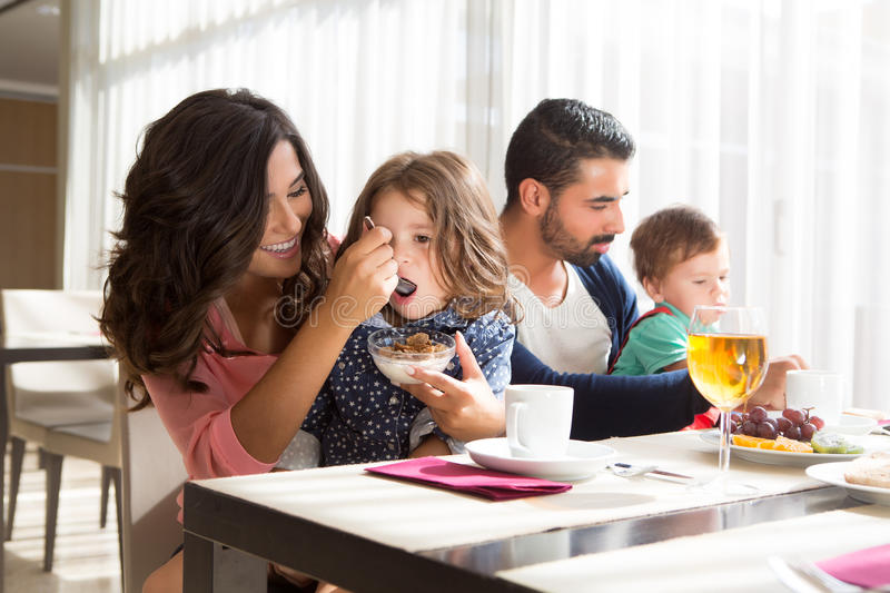 Family having breakfast. Young latin family having breakfast with kids stock photography