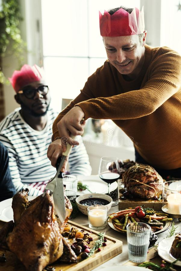 Family having a Christmas dinner royalty free stock images