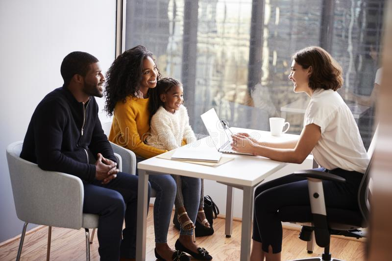 Family Having Consultation With Female Pediatrician In Hospital Office royalty free stock photography