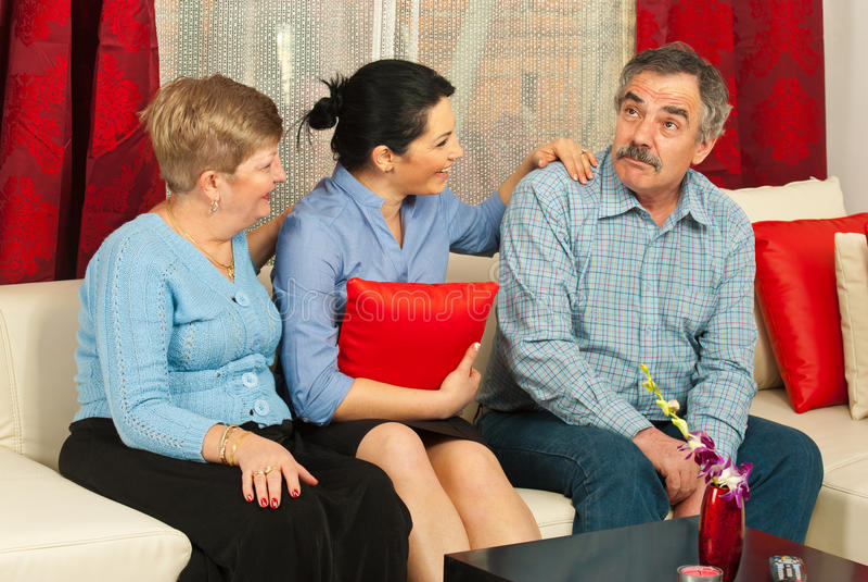 Family having conversation home stock photo