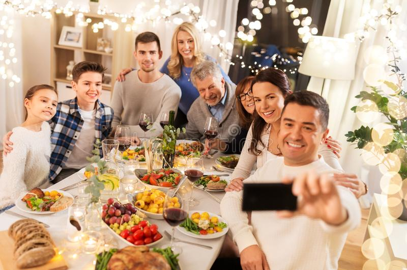 Family having dinner party and taking selfie royalty free stock image