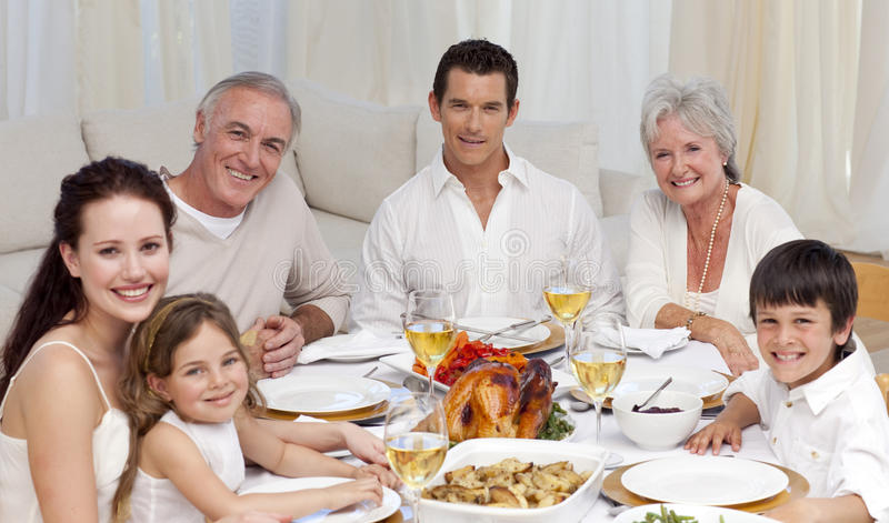 Download Family Having A Dinner Together At Home Stock Photo
