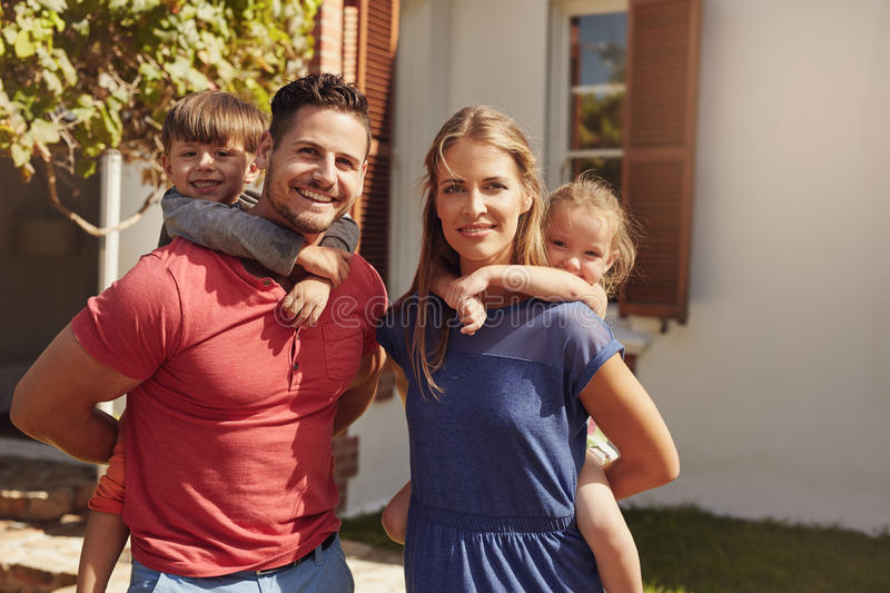 Family having fun in backyard together stock images