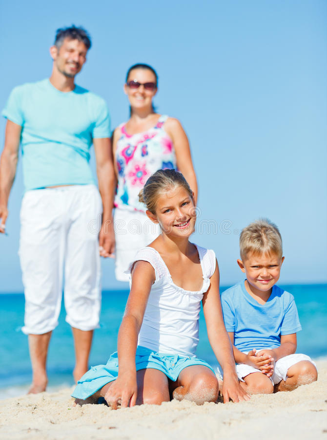 Family having fun on beach stock photography
