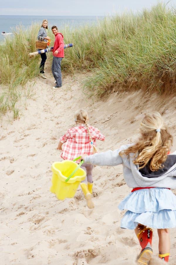 Family having fun on beach vacation royalty free stock photography