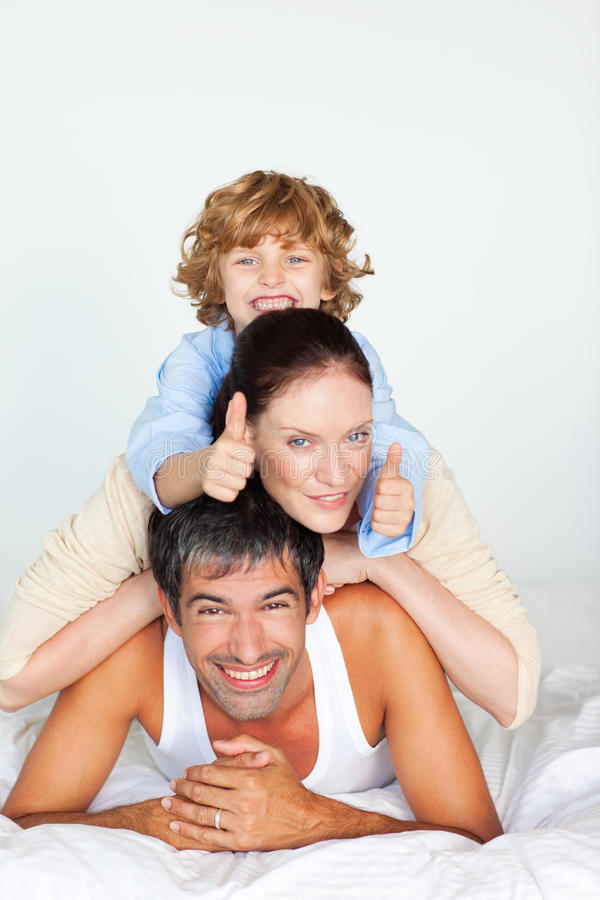Download Family Having Fun In Bed With Thumbs Up Stock Image - Image: 9619029
