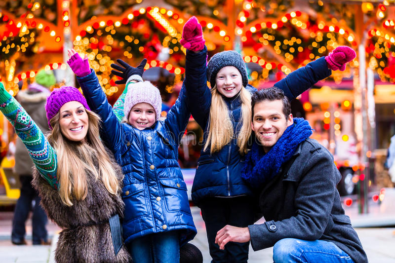 Family having fun on Christmas market royalty free stock images