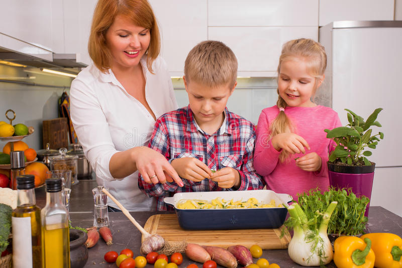Family having fun cooking in kitchen. Happy family having fun cooking in kitchen stock photos