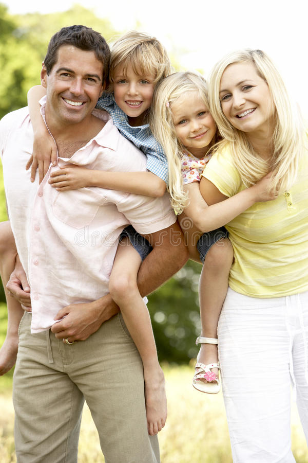 Family Having Fun In Countryside Stock Image
