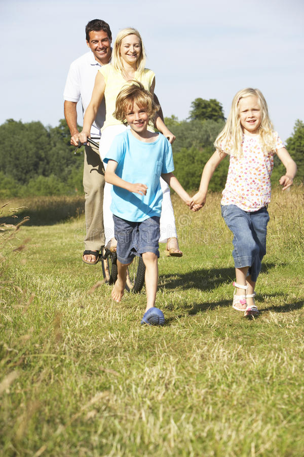 Family having fun in countryside stock photo