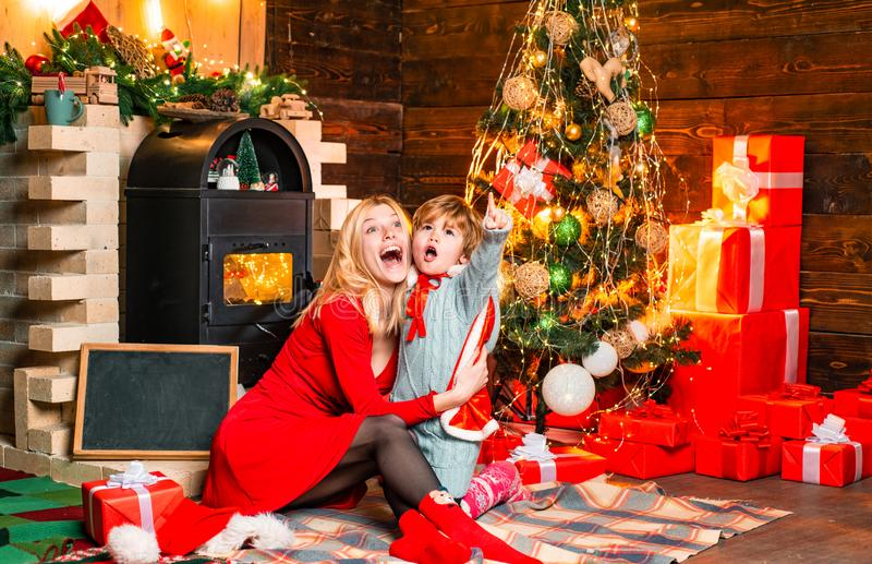 Family having fun at home christmas tree. Family holiday. Cozy evening at home. Mom and kid play together christmas eve royalty free stock photos