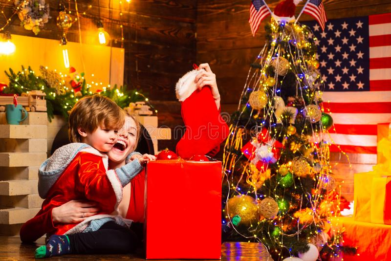 Family having fun at home christmas tree. Family holiday. Happy family. Mom and kid play together christmas eve. Mother stock images