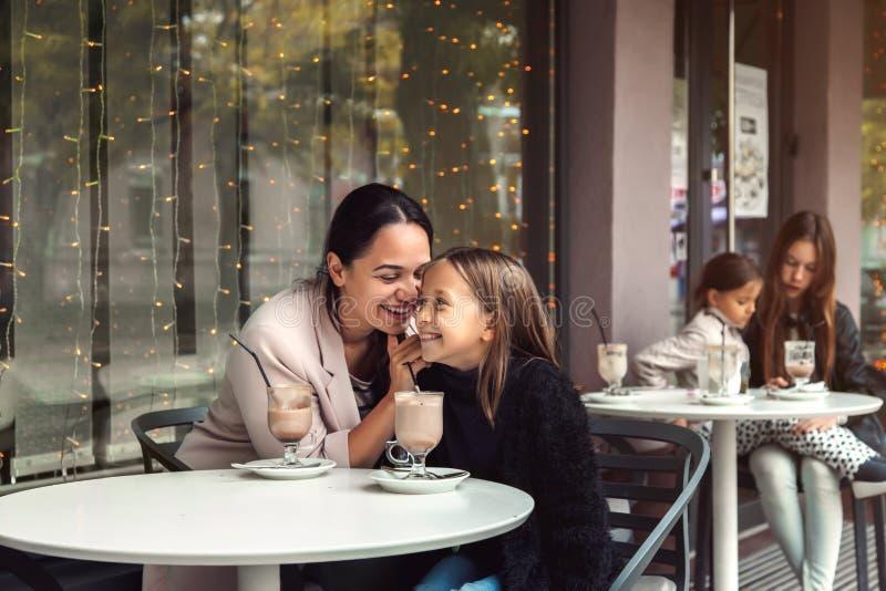 Family having fun in outdoor cafe stock photo