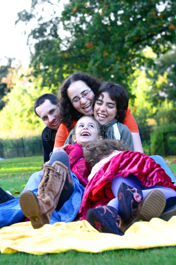 Family having fun in the park. royalty free stock photo