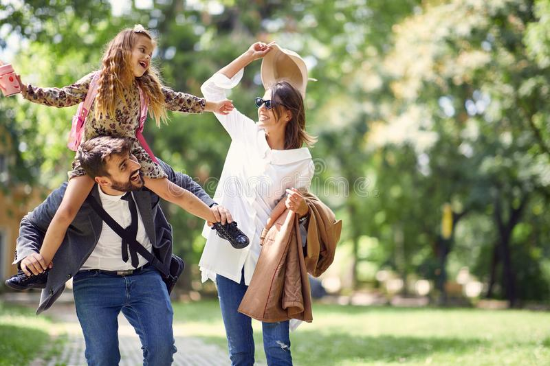 Family having fun in park after school stock photo
