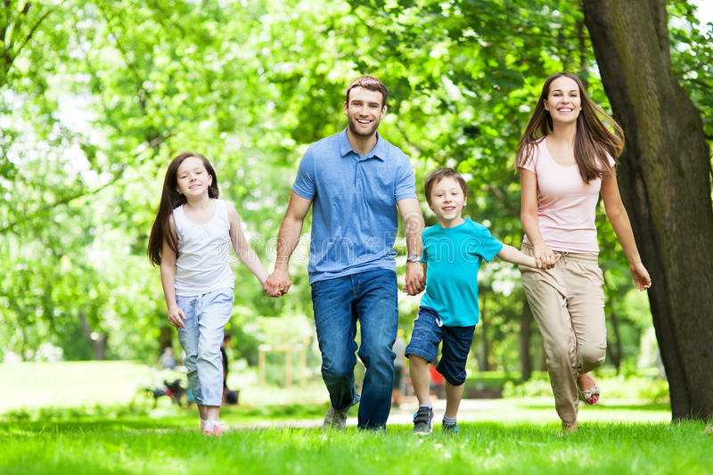 Family Having Fun In Park stock images