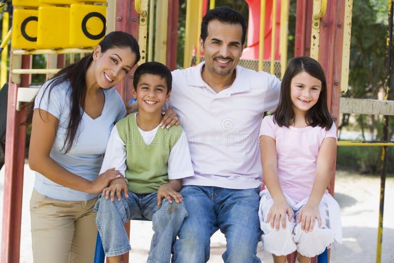 Family having fun in playground royalty free stock image