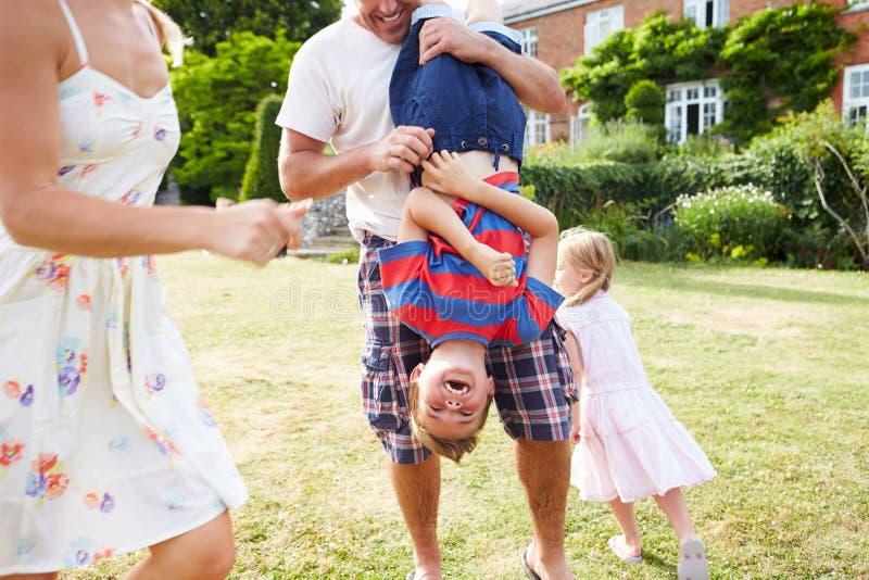 Family Having Fun Playing In Garden royalty free stock photos