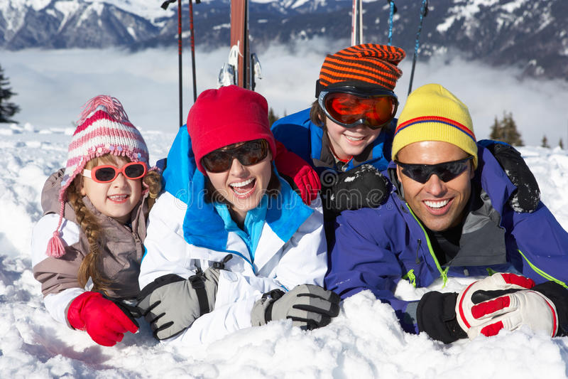 Family Having Fun On Ski Holiday In Mountains royalty free stock images