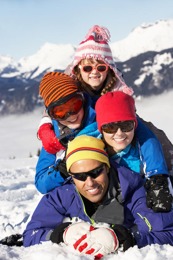 Family Having Fun On Ski Holiday In Mountains royalty free stock photography