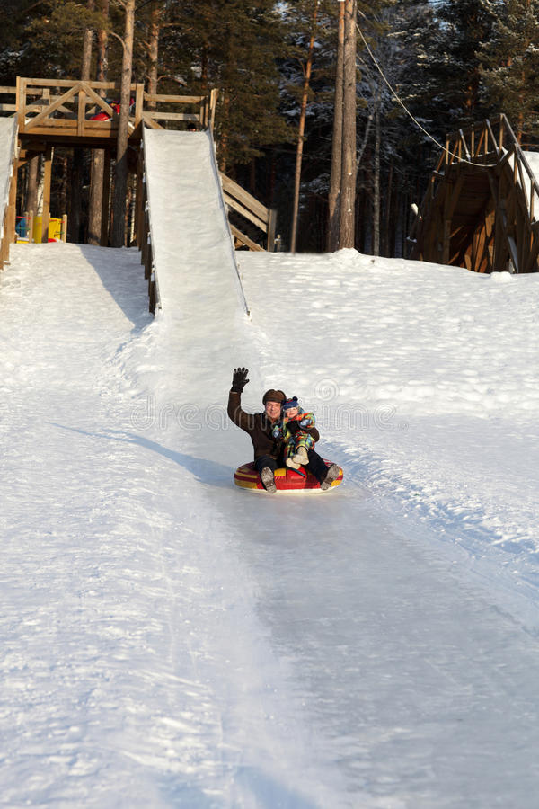 Family having fun on a sled royalty free stock photo