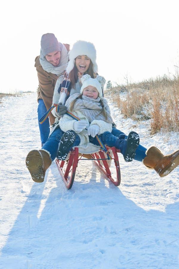 Family having fun with toboggan royalty free stock photo