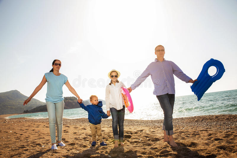 Family Having Fun Walking on Beach royalty free stock photography