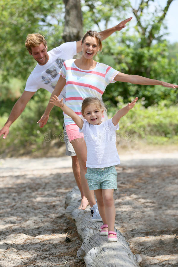 Free Family Having Fun Walking On Tree Trunk In Camp Royalty Free Stock Photos - 56111388