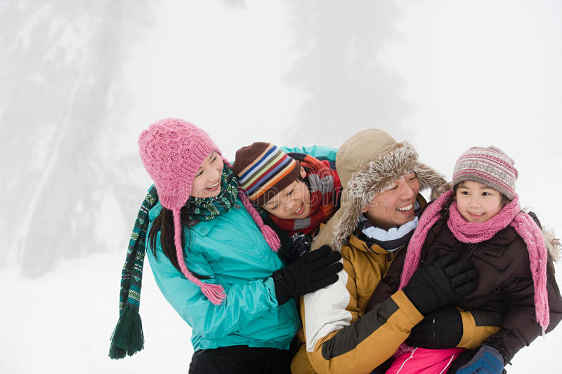 Family having fun in winter stock photography