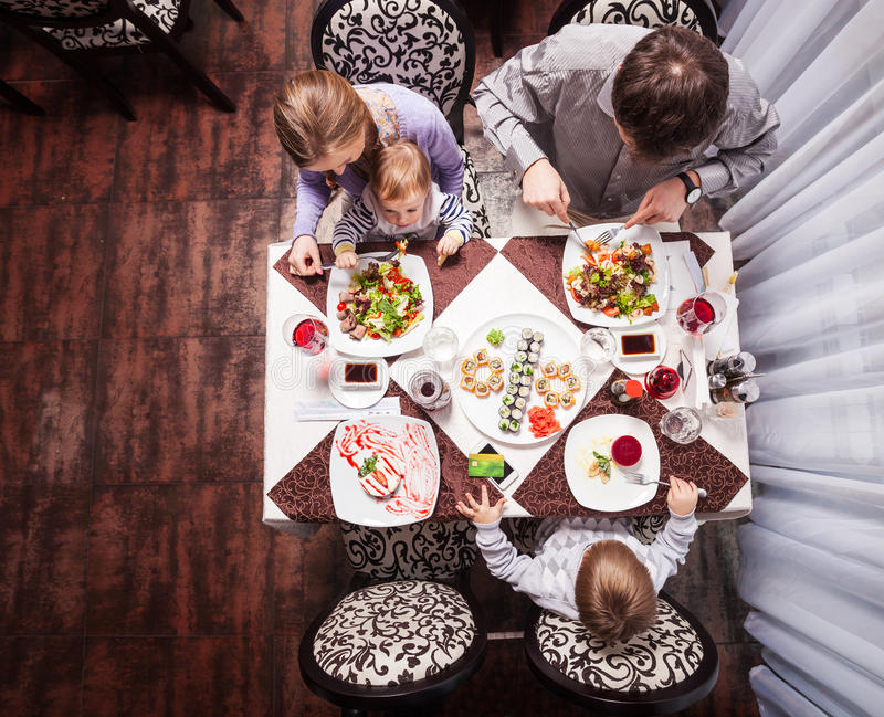 Family having meal at a restaurant royalty free stock photo