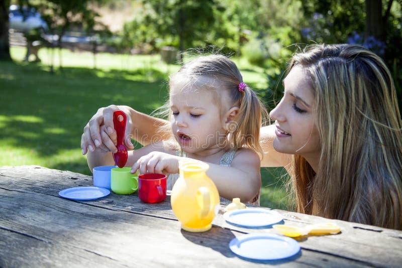 Family having picnic in summer park royalty free stock image