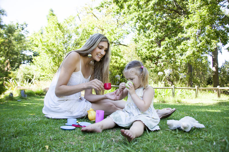 Family having picnic in summer park stock photography