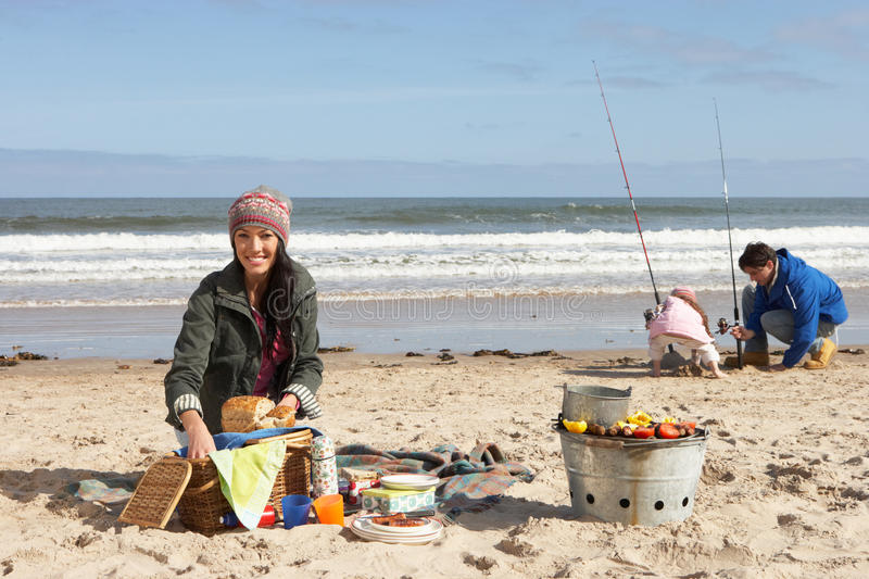 Family Having Picnic On Winter Beach stock photography