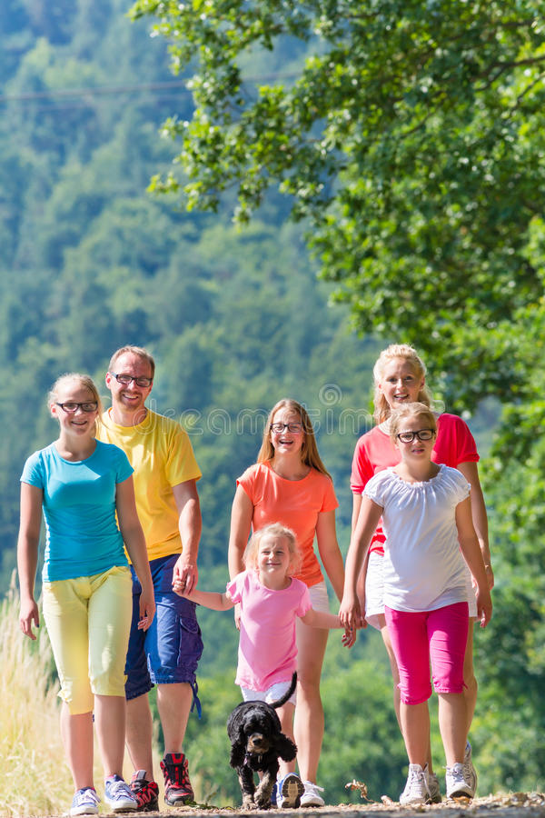 Family having walk on path in the woods. In summer royalty free stock photography
