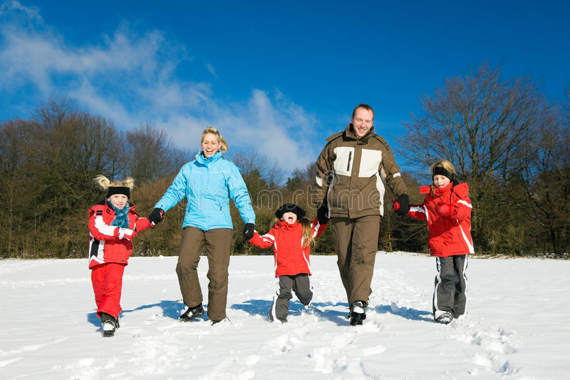 Download Family Having A Walk In The Snow Stock Photo - Image: 12270288