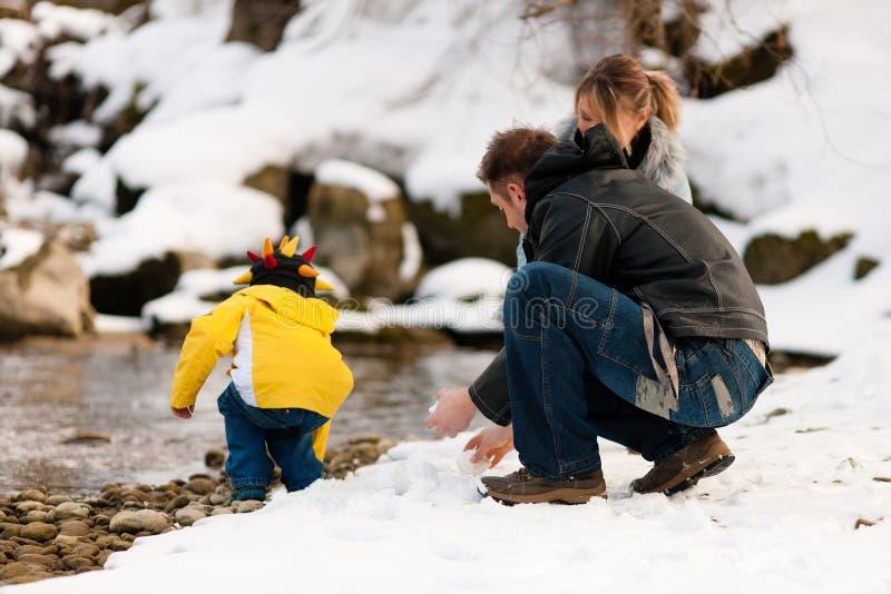 Family having winter walk at river royalty free stock photos