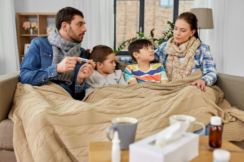 Family with ill children having fever at home royalty free stock photos
