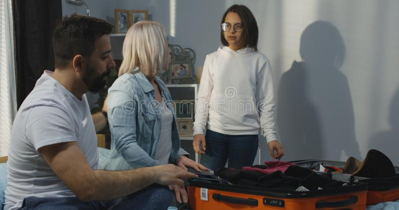 Family helping mother packing royalty free stock photo