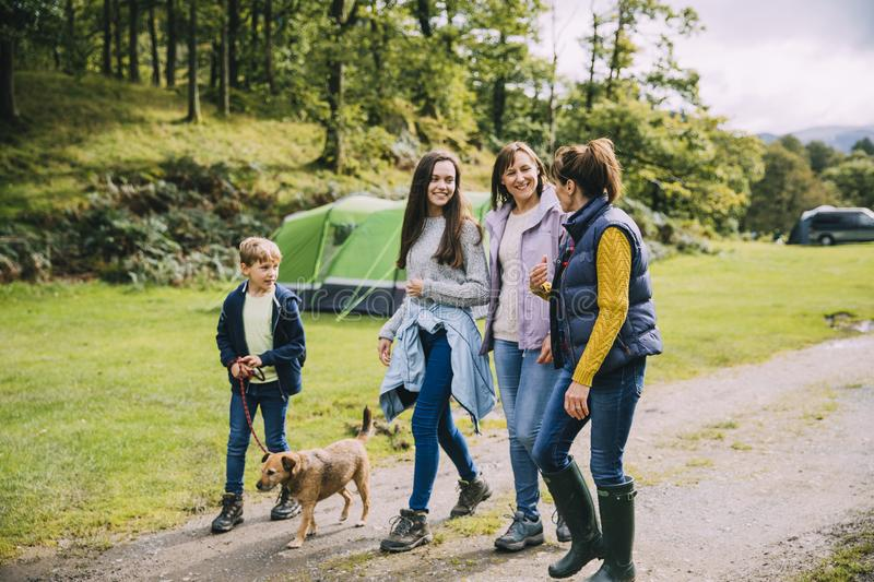 Family Hiking with the Dog. Family are leaving the campsite they are staying in to go for a hike with the dog royalty free stock photo