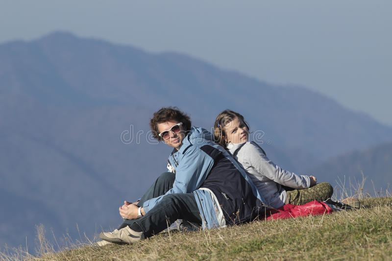 Family hiking in the mountains. Mother and daughter hiking in Predeal ski resort, Romania royalty free stock photography
