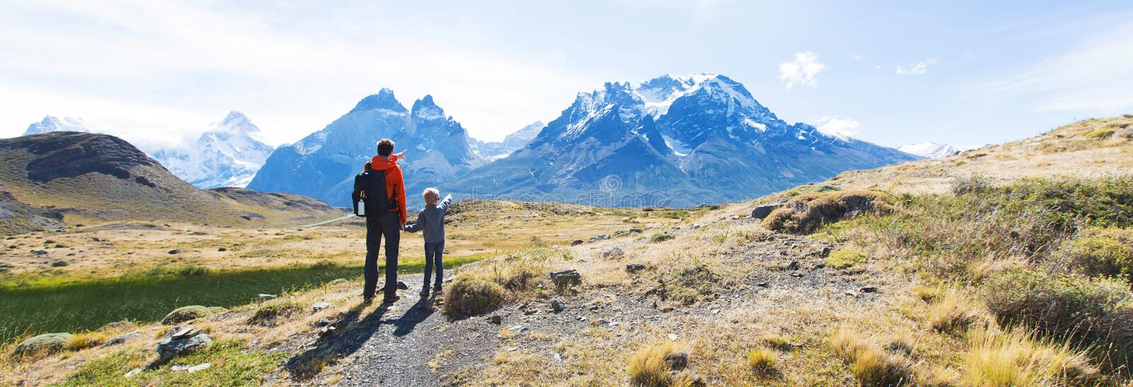 Family hiking in patagonia. Panorama view of family enjoying active vacation in patagonia and hiking in torres del paine national park, chile