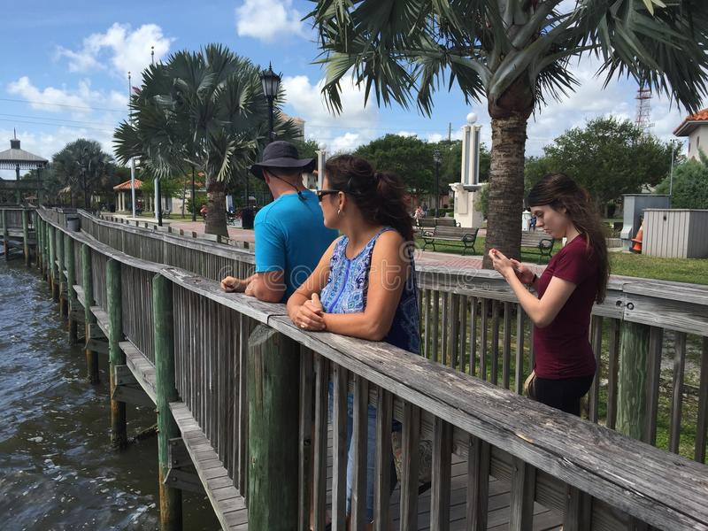 Family on Historic Boardwalk. People on Boardwalk in Historic Cocoa Florida royalty free stock photography