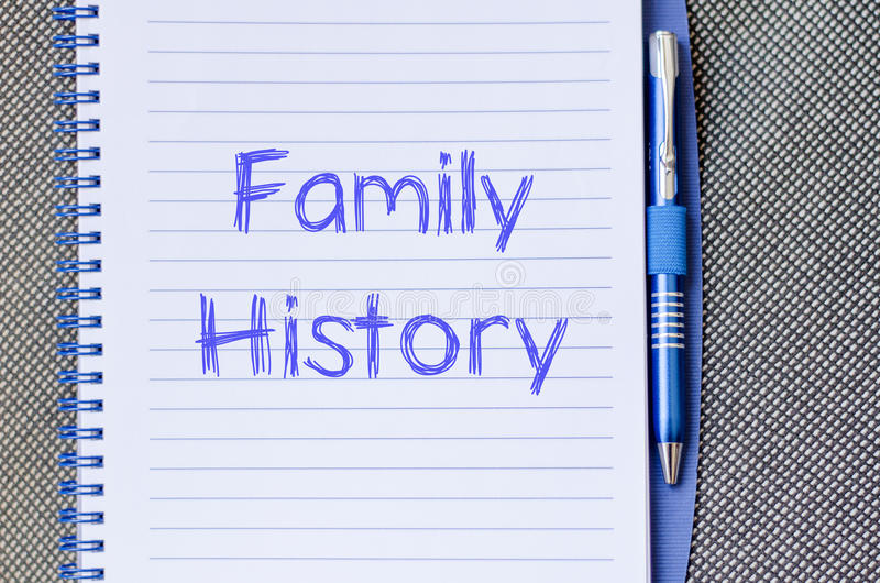 Family history write on notebook. Family history text concept write on notebook with pen stock photography