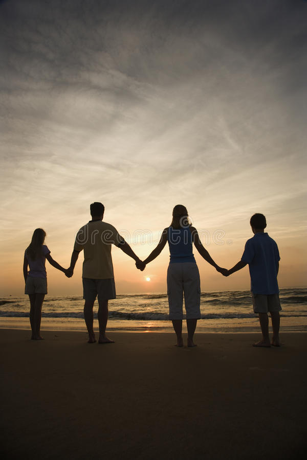Free Family Holding Hands On Beach Stock Photo - 12543430