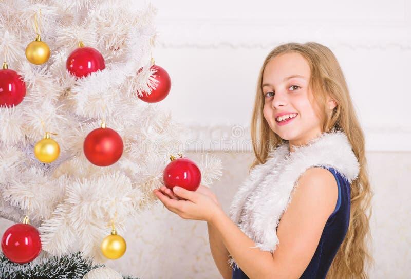 Family holiday concept. Girl velvet dress feel festive near christmas tree. Spread christmas cheer. Kid happy because royalty free stock photography
