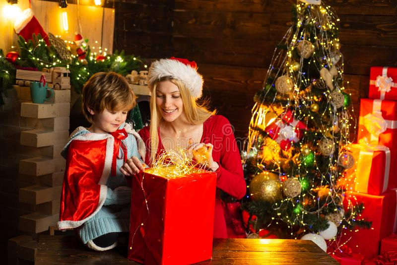 Family holiday. Cozy evening at home. Mom and kid play together christmas eve. Happy family. Mother and little child boy stock image