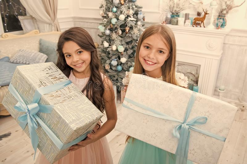 Family holiday. Cute little children girl with xmas present. happy little girls sisters celebrate winter holiday stock photos