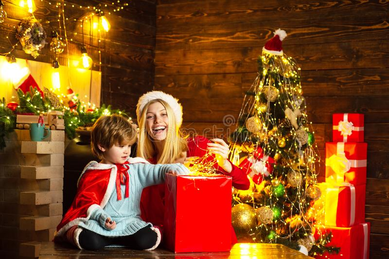 Family holiday. Happy family. Mom and kid play together christmas eve. My dear baby santa. Mother and little child boy stock images