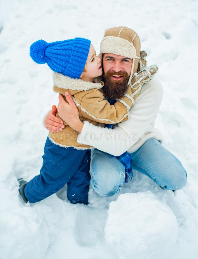 Family holiday and togetherness. Daddy and boy smiling and hugging. Best winter game for happy family. Concept of. Friendly family. Cute little child boy and stock photography