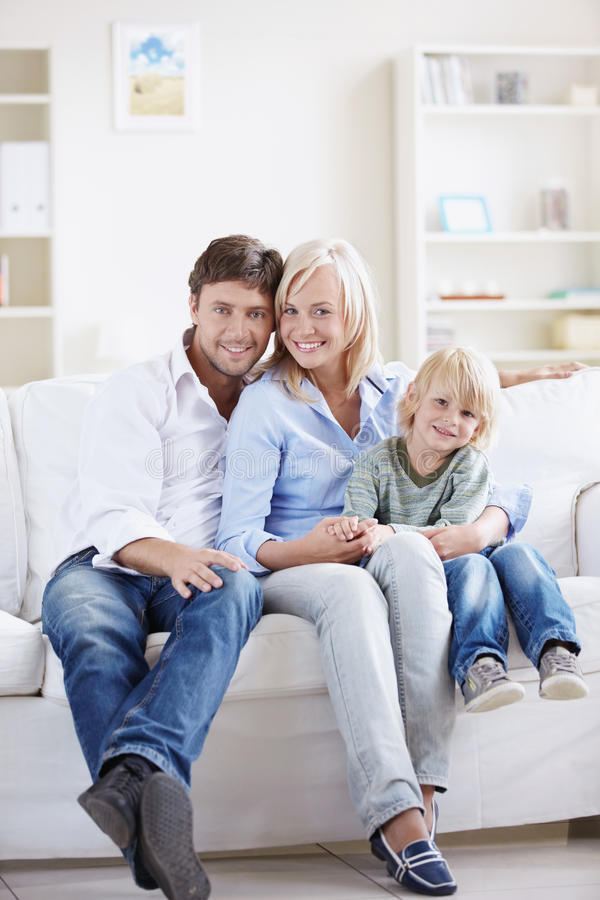 Family home. Attractive young family with a child at home